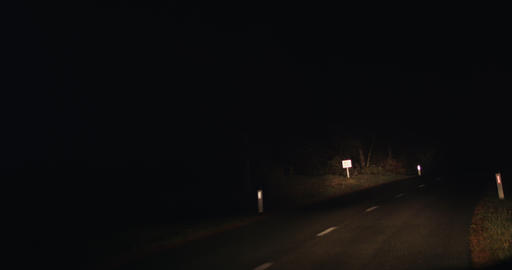 Drive on empty forest road dark autumn night fog point of view or pov Live Action