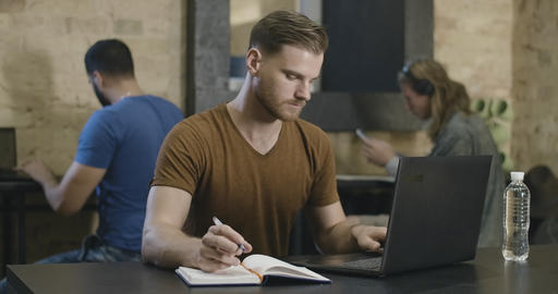 Portrait of concentrated Caucasian young man working or studying online with Live Action