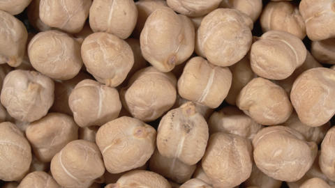 Rotation of chickpea close-up. Macro image. 4K video. Legumes Live Action