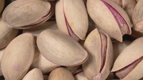 Rotation of nut pistachio close-up. Pistachio nuts in the peel. Whole nut Live Action