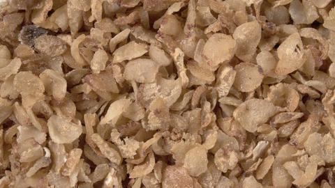Rotation of buckwheat flakes close-up. Instant buckwheat Live Action