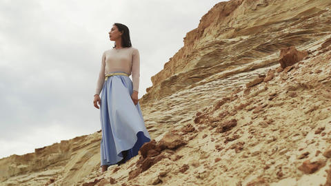 Fashion model in blue skirt posing in the desert Live Action