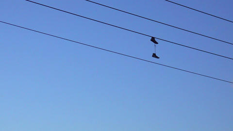 shoes haning on a power line Footage