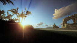Tropical island with palm trees and rocks in ocean, morning mist, panning Animation