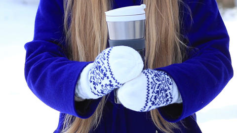 Female hands with thermal coffee mug in winter day Footage