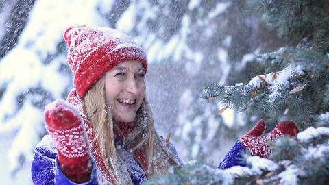 Happy woman in winter forest getting snow shower Footage