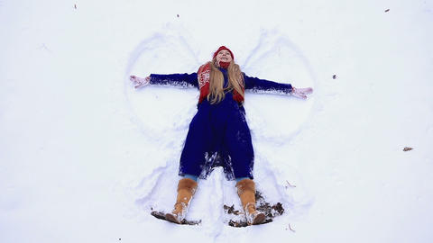 Young happy woman having fun on snow Footage