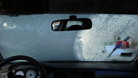 Cleaning car window with an ice scraper Footage