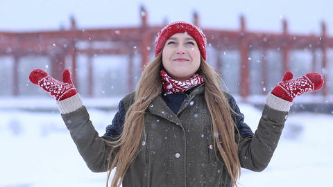 Happy young woman enjoying first snow Footage