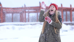 Winter woman playing in snow throwing snowballs Footage