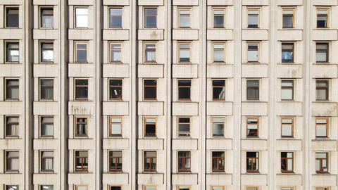 Urban architecture: Many windows of a building. Slow motion Live Action