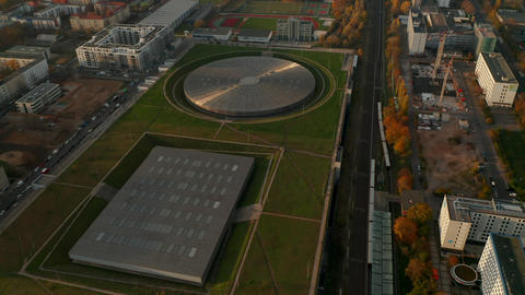Establishing Aerial Shot above Futuristic Velodrome Building cycling Arena in Live Action