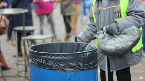 People throwing litter in waste bin, environmental pollution, global consumerism Footage