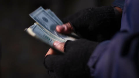 Hands of bank robber or drug dealer counting money, income from illegal acts Live Action