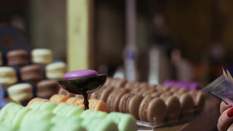 Elegant lady buying handmade sweets at confectionery, gastronomic shopping Footage