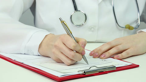 Doctor working in office, writing prescription for medication. Healthcare system Footage