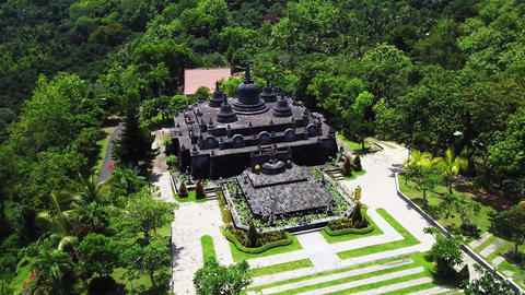 Buddhist temple Brahma Vihara Arama with statues of the gods on Bali island Live Action