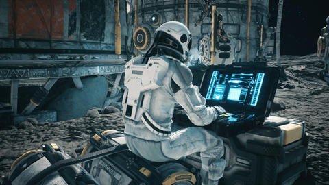 An astronaut works on his laptop at a space base on one of the new planets. Animation for fantasy, Animation