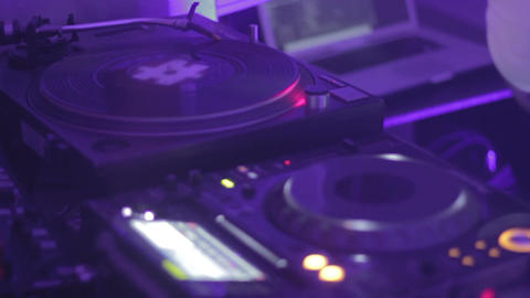 Night club audio equipment. Dj playing music. Relaxation atmosphere. Hobby Footage