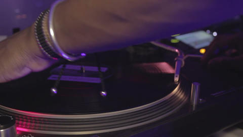 Cool dj spinning platter, performing modern music at the night club. Dancing Footage