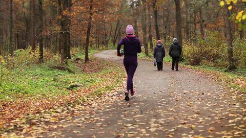 retirees walking youth jogging Footage