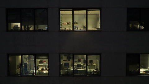zoom out of empty offices at night Footage
