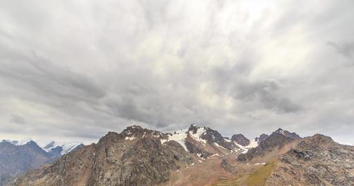 Clouds over snowy peaks. Chimbulak. Almaty. Kazakhstan. Time Lapse Footage
