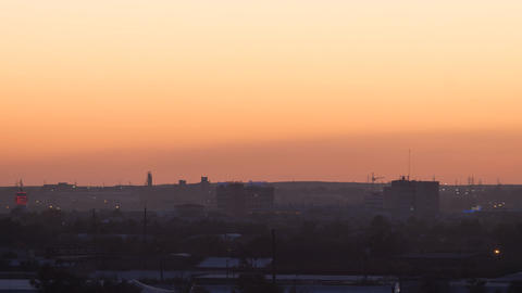 Sunset over the industrial city. Sun close-up. Karaganda, Kazakhstan. Panorama.  Footage