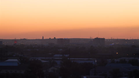 Sunset over the industrial city. Sun close-up. Karaganda, Kazakhstan. TimeLapse Footage