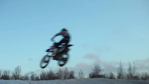 Jumping on a motorcycle motocross of winter Footage