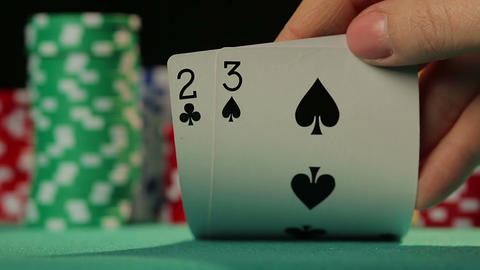 Gambler checking cards, starting match with bad hand, unlucky man losing game Footage