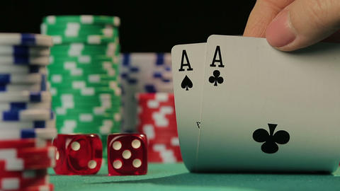 Hand of gambler checking playing cards, person tempting fate in poker game Footage