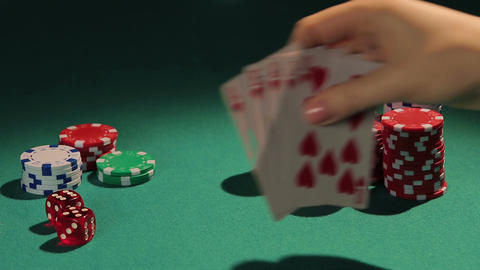 Lucky gambler, winner showing royal flush hand, fortunate person winning game Footage