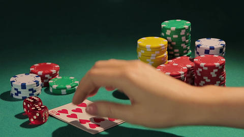 Happy female poker player showing best poker combination, royal flush hand Footage