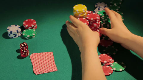 Reckless gambler betting all chips in poker game, wants to win big money, casino Footage