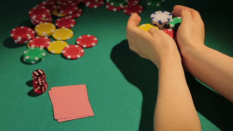 Gambling addict betting chips cautiously, risky poker match, passion for game Footage