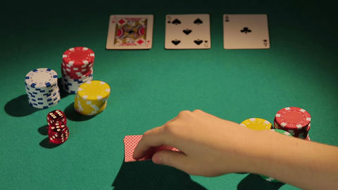 Experienced gambler using risky bluff strategy to win more money in poker game Live Action