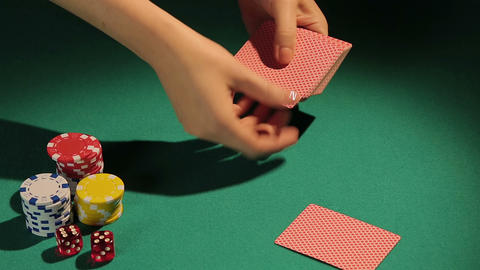 Female hands dealing cards to poker player, risky game to face challenge of fate Live Action