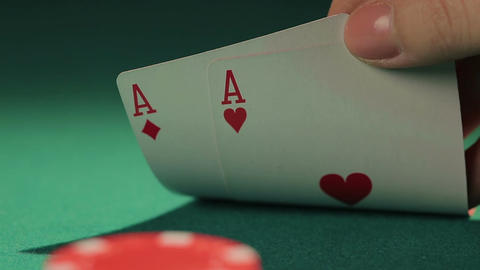 Gambler checking cards before betting, playing poker cautiously to win big bank Footage