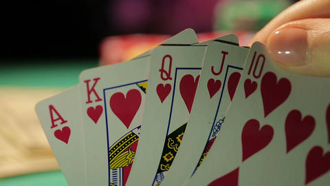 Gambling fraud, gamer catches royal flush, dollar bills, pile of chips on table Footage