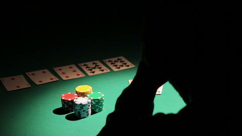 Male obsessed with gambling losing all money in poker game, man in despair Live Action