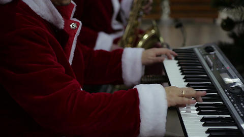 Happy musicians performing Christmas songs on piano and saxophone at concert Footage