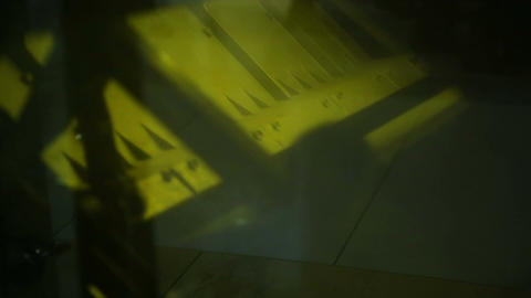Shadows of people passing by while massive mechanism moving fast, daily routine Footage
