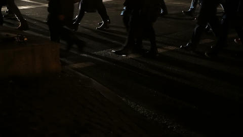 People crossing dark street, crowd of commuters returning home late at night Footage