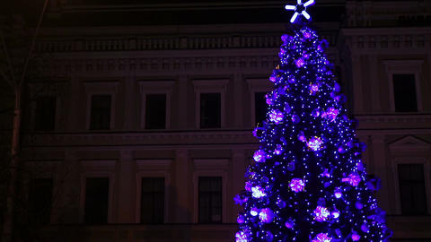 Bright lights sparkling on fantastic New Year tree in central square of big city Footage