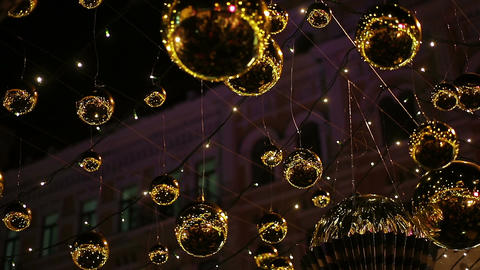 Magic twinkle lights sparkling brightly outdoors, Christmas street decorations Footage
