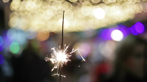 Festive Bengal fire sparkling brightly, creating good mood, New Year celebration Footage