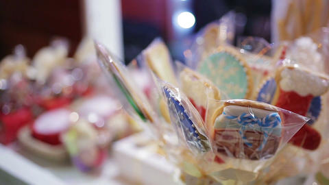 Traditional sweet souvenir cookies and chocolates sold at Christmas fair trade Footage