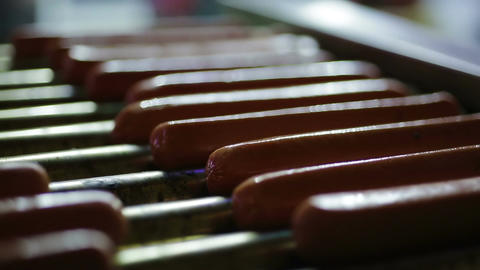 Appetizing hotdog sausages being cooked on grill, snacks at street food festival Footage