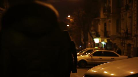 Many people enjoying evening walk through central street of big city, weekend Footage